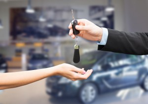 close up of customer and salesman with car key